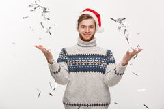 Chirstmas Concept - Happy young caucasian beard man throwing confetti celebrating for Christmas day. Chirstmas Concept - Happy young caucasian beard man Stock Photography