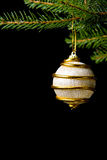 Chirstmas Decoration. Some golden christmas decoration isolated on black Royalty Free Stock Photo