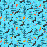 Chirstmas seamless pattern with cute deers in children's style. Royalty Free Stock Photography