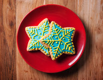 Chirstmas snow flake cookies in red plate Royalty Free Stock Image