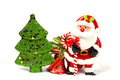 Chirstmas tree, bell, santa claus. On white background Royalty Free Stock Photo