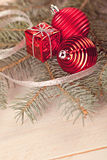 Chirtmas balls on fir. Christmas composition with red toys Stock Image