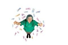 Chirurg unternimmt das Jackpotgeld, welches die türkische Lira fliegt, die auf dem weißen Hintergrund lokalisiert wird Lizenzfreies Stockfoto