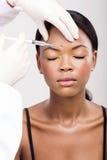 Chirurgia plastica africana della donna Immagini Stock