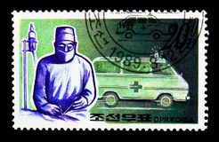 Chirurgien et ambulance, serie de services publics, vers 1989 Images libres de droits