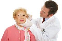 Chirurgo cosmetico sul lavoro Immagini Stock Libere da Diritti