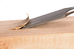 Chisel carving wood. A sharp chisel chips away at a wood surface.  The image can be used for any tooling, fabrication or construction inference Stock Photography