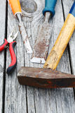 Chisel and a hammer on the  boards Royalty Free Stock Image