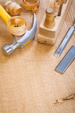 Chisel hammer woodworkers plane on wooden board Stock Image