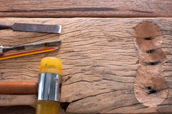The chisel hammering on wood. The chisel hammering and pencil on wooden working royalty free stock photo
