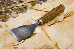 Chisel laying on the wood Royalty Free Stock Images