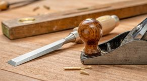 A chisel and a plane aon wooden background stock photos