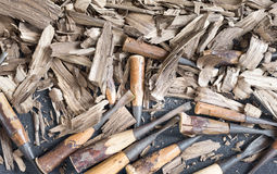 Chisel wood carving Stock Images