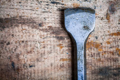 Chisel on wooden plank Stock Images
