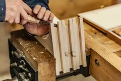 Chisel working and sawdust on wooden press. Woodworking lifestyle, organic eco friendly design elements. Eco-friendly woodworker`s shop. Details and focus on stock photos