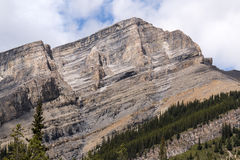 Chiseled primordial block. A chiseled and primordial mountain in Kananaskis country royalty free stock image