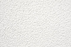 Chiseled wall. White chiseled pattern wall background royalty free stock image