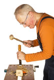Chiseling and carving the wood Stock Photo