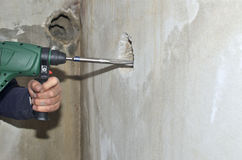 Chiseling a Hole in a Wall Royalty Free Stock Photos