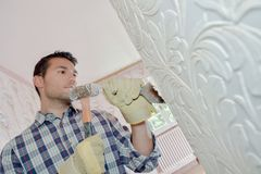 Chiseling at old wall Stock Image