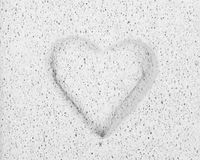 Chiselled heart in stone Stock Photos
