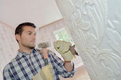 Chiselling away at wall. Chiselling away at the wall Royalty Free Stock Image