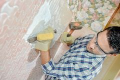 Chiselling wall motif. Chiselling of a wall motif Stock Photography