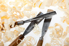 Chisels and wood shavings on white background Royalty Free Stock Images