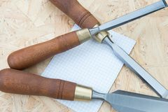 Chisels on a natural wooden background. Professional Chisels on a natural wooden background, Place for text Royalty Free Stock Image