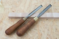 Chisels on a natural wooden background. Professional Chisels on a natural wooden background, Place for text Stock Images
