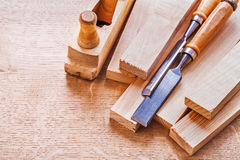 Chisels planks and woodworkers plane on wooden Royalty Free Stock Image