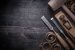 Chisels shaving plane lump hammer planning chips Royalty Free Stock Photo
