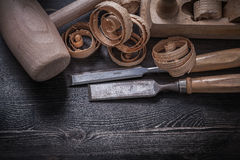 Chisels shaving plane wooden scobs lump hammer. Construction concept Royalty Free Stock Photo