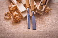 Chisels shavings planks woodworkers plane on Stock Photography