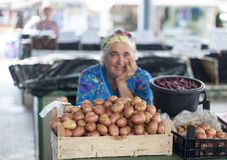 Chisinau market. Very nice and smiling lady, out of focus, behind the potatoes in evidence, near the central market of chisinau Moldova stock images