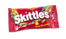 Pack of Fruit Skittles. Chisinau, Moldova, April 21, 2018: Pack of Fruit Skittles over a plain white background, with clipping path. The Skittles sweets brand is Stock Images