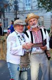Chisinau, Moldova, 10.14.2014, Elderly couple with smiles on their faces, dressed in folk costumes, on a holiday in the city of Ch Royalty Free Stock Photography