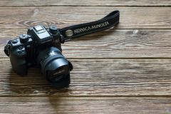 Chisinau, Republic of Moldova - March 14, 2018: dslr camera Minolta a 7 and lens on wooden background in Chisinau, Republic of Mol Royalty Free Stock Images
