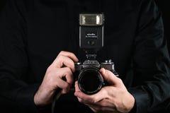 Free Chisinau, Republic Of Moldova - March 12, 2019: Man Photographer Holding A Camera. Shooting Process. Japan Retro Photo Camera Stock Photo - 144982000