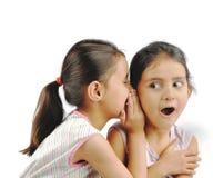 Chisme de los niños. fotografía de archivo