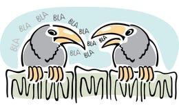 Chisme. El hablar de dos cuervos. Fotografía de archivo