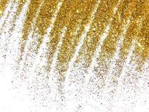 Chispa de oro del brillo como una lluvia de oro en el fondo blanco foto de archivo