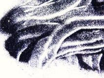 Chispa negra del brillo aislada en el fondo blanco imagen de archivo
