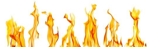 Chispas de siete llamas amarillas brillantes en blanco imagenes de archivo