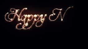 Chispas que escriben Feliz Año Nuevo almacen de metraje de vídeo