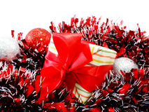 chistmas background with gift box and red tinsel Royalty Free Stock Images
