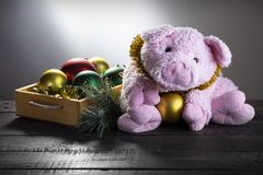 Chistmas background with toy pig and New year balls. Present card, New Year of Pig, Zodiac symbol 2019. With space for text royalty free stock photo