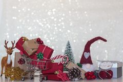 Free Chistmas Background With Wrapped Gifts, Christmas Tree, Reindeer, Pine Cone, Shopping Cart And Christmas Elf Stock Image - 200999771