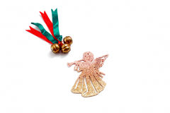 Chistmas decoration. Christmas decoration of gold bell bow and angel toy Royalty Free Stock Photography