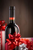Chistmas gifts and wine bottle Royalty Free Stock Photos